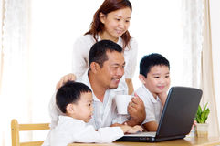 Asian family. Using laptop at home Royalty Free Stock Images