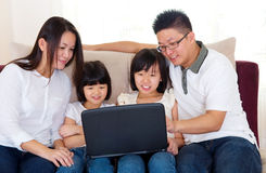 Asian family. Using laptop at home Stock Photos