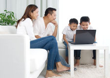 Asian family. Using laptop at home Stock Photo
