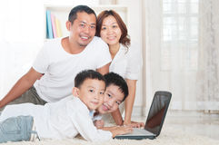 Asian family. Using laptop at home Stock Image