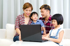 Asian family using laptop. Portrait of asian family using laptop at home royalty free stock image