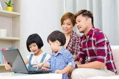 Asian family using laptop. Portrait of asian family using laptop at home stock photography