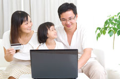 Asian family. Using laptop to perform online shopping Stock Images