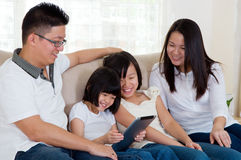 Asian family. Using tablet computer Royalty Free Stock Photography