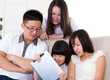 Asian family. Using tablet computer Royalty Free Stock Image
