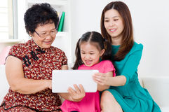 Asian family. Using tablet computer Stock Images