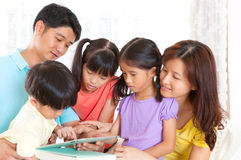 Asian family. Using tablet computer Stock Photo