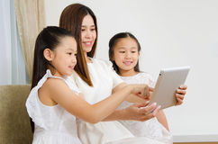 Asian family using tablet computer Royalty Free Stock Photos