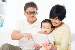 Asian family using tablet pc Royalty Free Stock Images