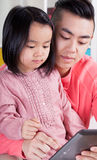 Asian family using tablet Stock Images