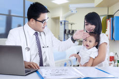 Asian family visiting doctor Stock Images