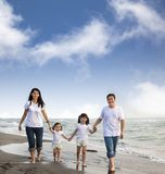 Asian Family Walking On The Beach Royalty Free Stock Images