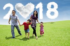 Asian family walking together in the park Stock Photos