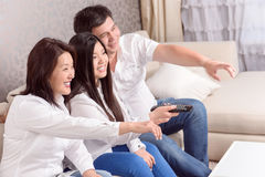 Asian family watching films at home Royalty Free Stock Images