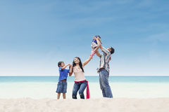 Asian family at white sand beach Stock Image
