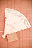 Asian Fan on Bamboo Mat Royalty Free Stock Photos
