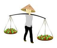 Asian farmer with baskets of produce Stock Photos