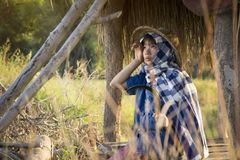 Asian farmer girl working at rice field on harvest season. Selective and soft focus Stock Image
