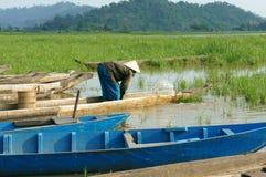 Asian farmer, row boat, family, go to work Royalty Free Stock Image