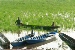 Asian farmer, row boat, family, go to work Royalty Free Stock Photography