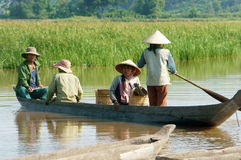 Asian farmer, row boat, family, go to work Royalty Free Stock Photos