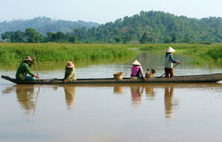 Asian farmer, row boat, family, go to work Stock Photos