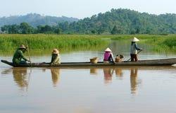 Asian farmer, row boat, family, go to work Stock Photos