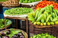 Asian farmer's market selling fresh vegetables Royalty Free Stock Photo