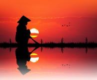 Asian farmer at sunset Stock Photo