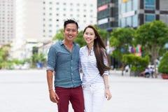 Asian fashion couple smile city street embrace Royalty Free Stock Photography