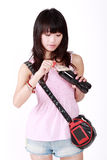 Asian fashionable girl. An Asian fashionable girl is opening bottle of drink Royalty Free Stock Photography