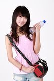 Asian fashionable girl. A Asian fashionable girl is holding a bottle of water Stock Photography