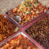 Asian fast food at Cambodian market. Street photo of asian market food in Cambodia. Close-up of crab claws, frogs, fish, locust Stock Image