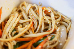 Asian fast food. fryed noodles in open take away box Royalty Free Stock Image