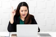 Asian fat businesswoman sitting and thinking a new ideas stock photo