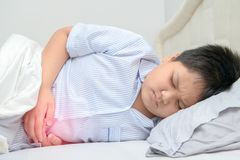 Asian fat child suffering from stomachache royalty free stock photo