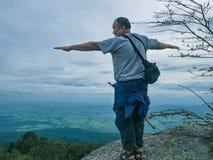 Asian Fat traveler trekking on Khao Luang mountain in Ramkhamhaeng National Park. Sukhothai province Thailand royalty free stock image