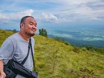 Asian Fat traveler trekking on Khao Luang mountain in Ramkhamhaeng National Park. Sukhothai province Thailand royalty free stock photos