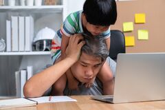 Free Asian Father Attempt To Work At The Home Office With A Laptop With A Daughter Who Came Into Chaos. New Lifestyle Normal During A Royalty Free Stock Image - 185872746