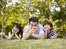 Asian father and children having fun outdoors Stock Image