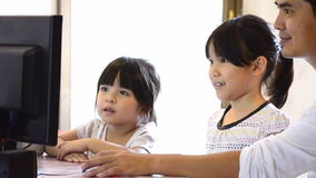 Asian Father And Cute Daughter Playing Computer stock video footage