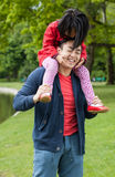 Asian father with daughter in park Royalty Free Stock Image