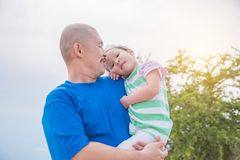 Father holding his daughter in park Stock Photos