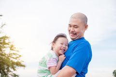 Father holding his daughter in park Royalty Free Stock Images