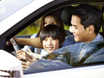 Asian father letting son hold the steering wheel Royalty Free Stock Photo