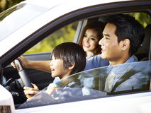 Asian father letting son hold the steering wheel Stock Images
