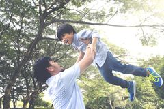 Asian father lifting his son Stock Images