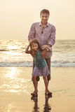 Asian father playing and having with his daughter on beach stock photography