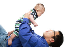Asian father and son. An isolated shot of an asian father and a son cuddling Stock Photo