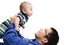 Asian father and son. An isolated shot of an asian father playing with his son Royalty Free Stock Photos